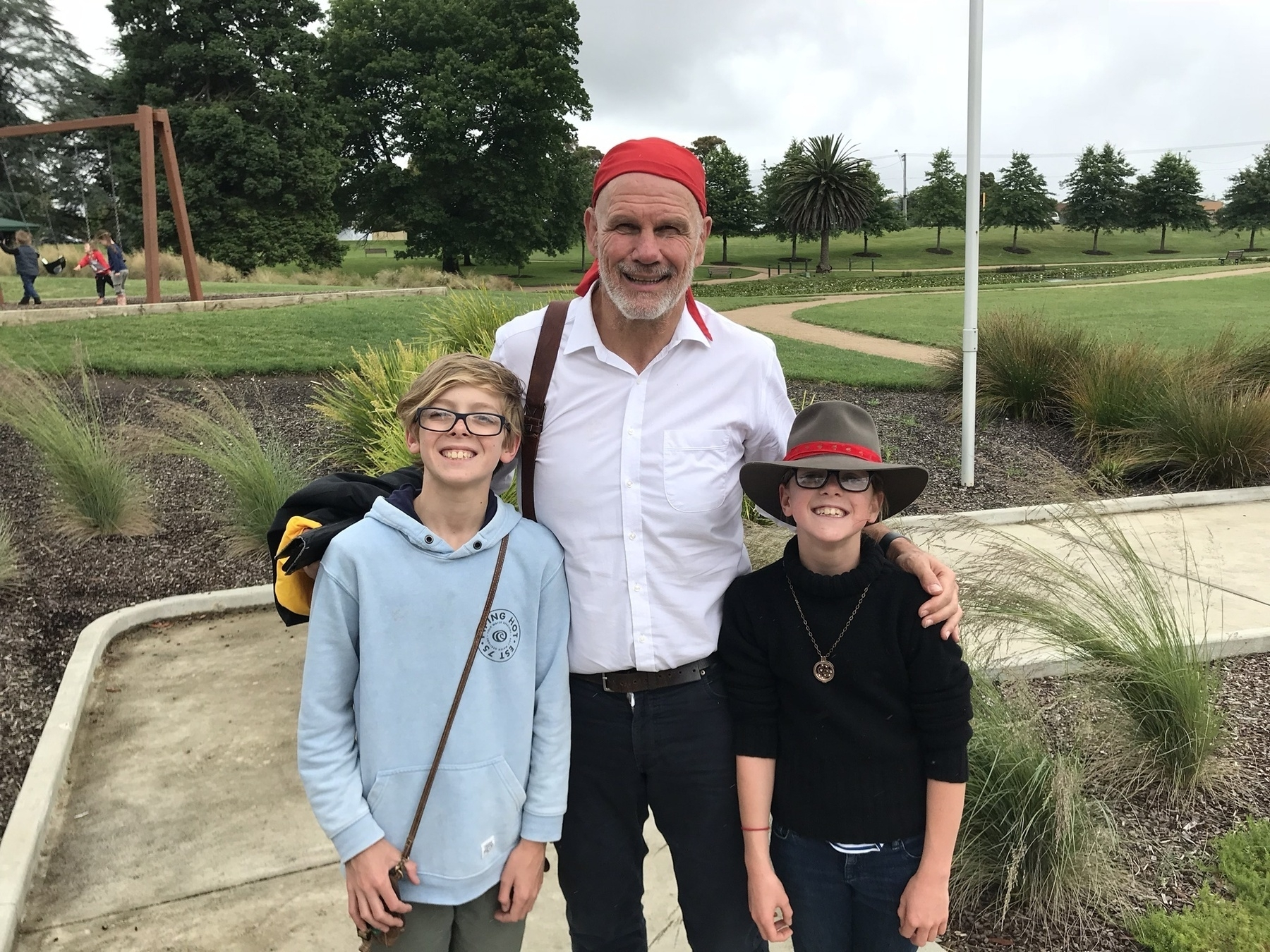 """The author Peter FitzSimons (centre) with my son Declan (left) and daughter Anneliese (right) outside the now-defunct """"Museum of Australian Democracy in Eureka (MADE)""""."""